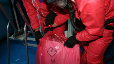 Team working with asbestos removal bags
